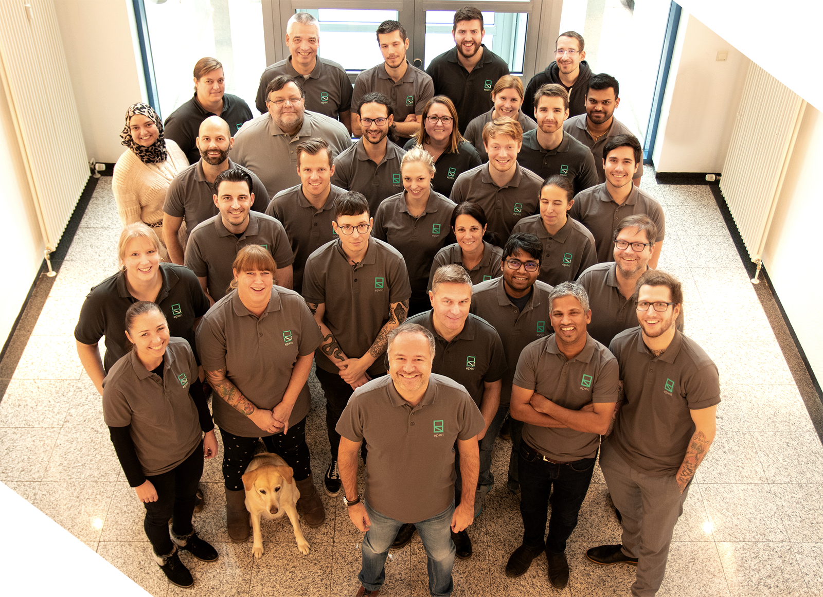 Group photo of employees and CEO